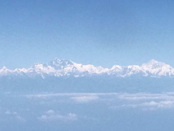 View of Mount Everest from 36,000 ft, high up in the sky. Picture is hazy as it is taken from the aircraft window.